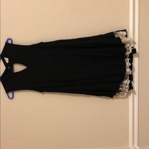 Black sleeveless dress with lace detail